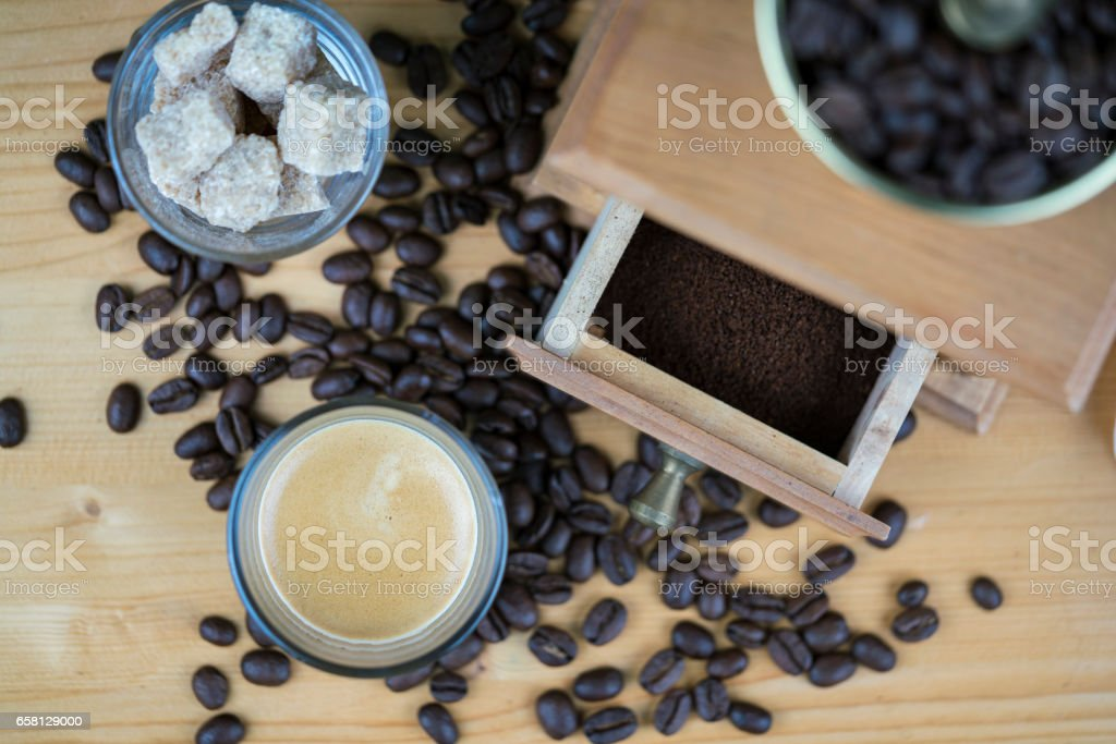 Coffee grinder with espresso and sugar cubes stock photo