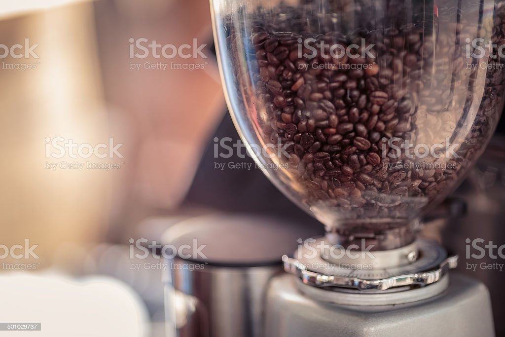 Coffee grinder  with fresh coffee in cafe stock photo