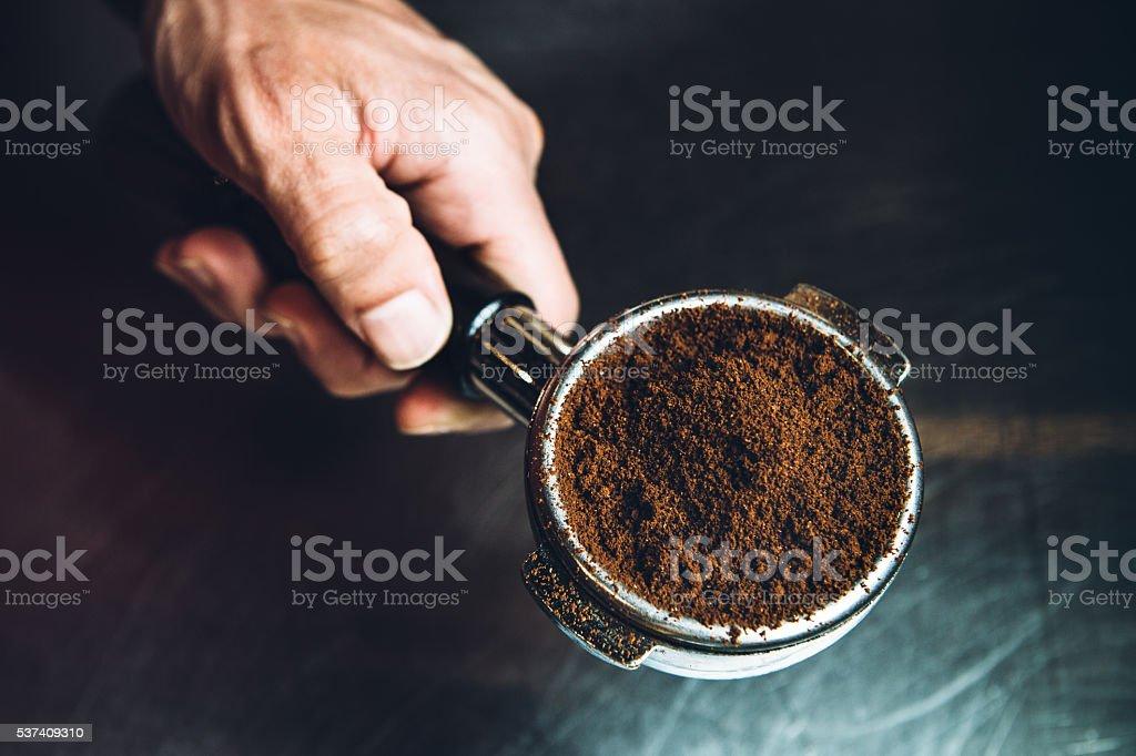 Coffee Ground in Portafilter for Espresso stock photo