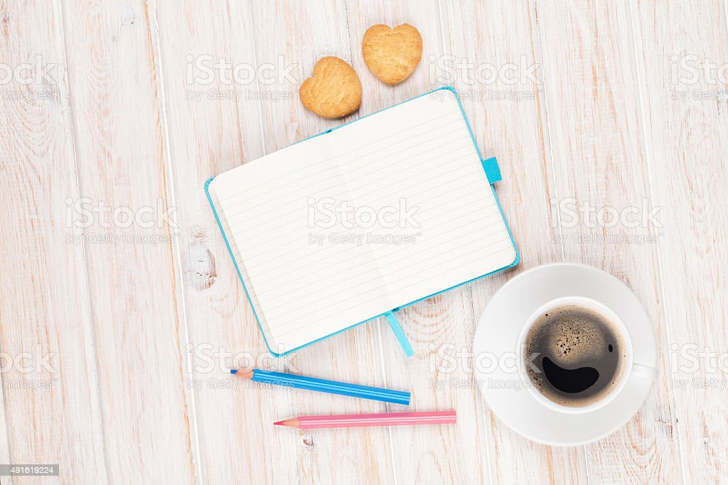 Coffee, heart shaped cookies and notepad stock photo