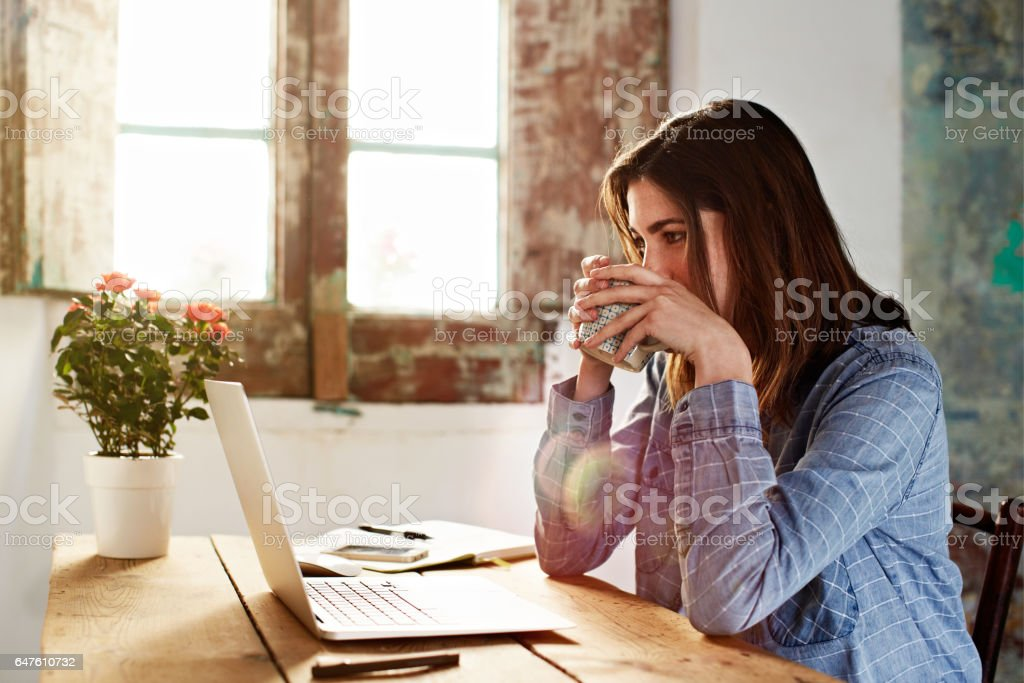 Coffee helps with her inspiration stock photo