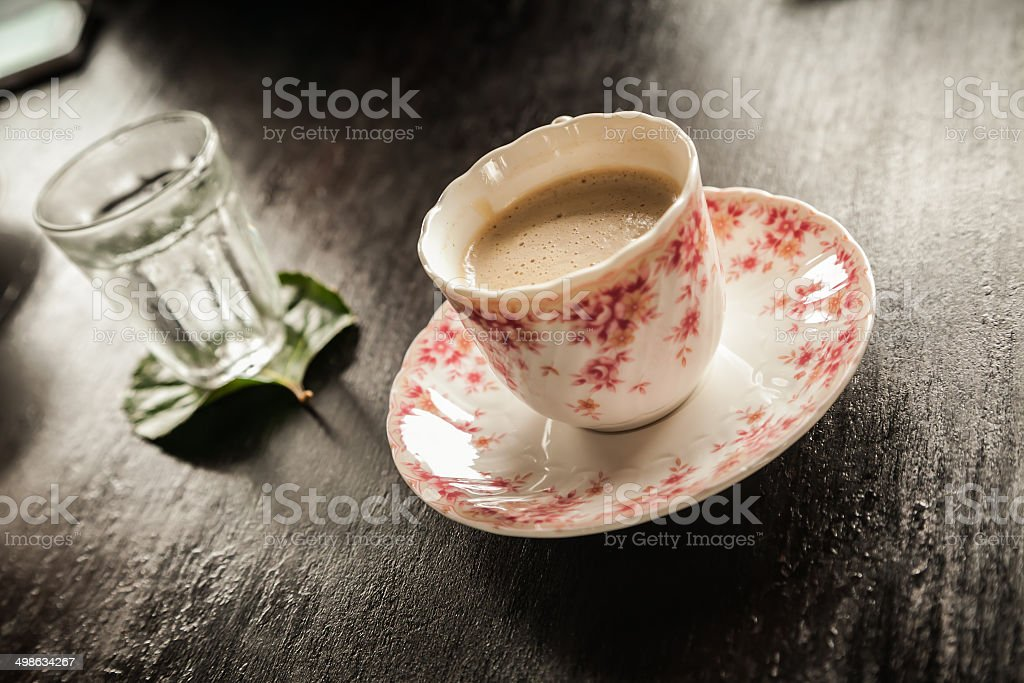 Coffee in a Cup and Saucer stock photo