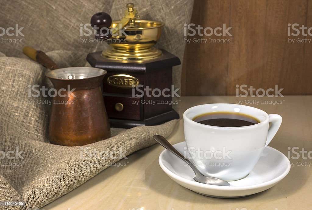 Coffee in a cup, hand-mill and Cezve royalty-free stock photo