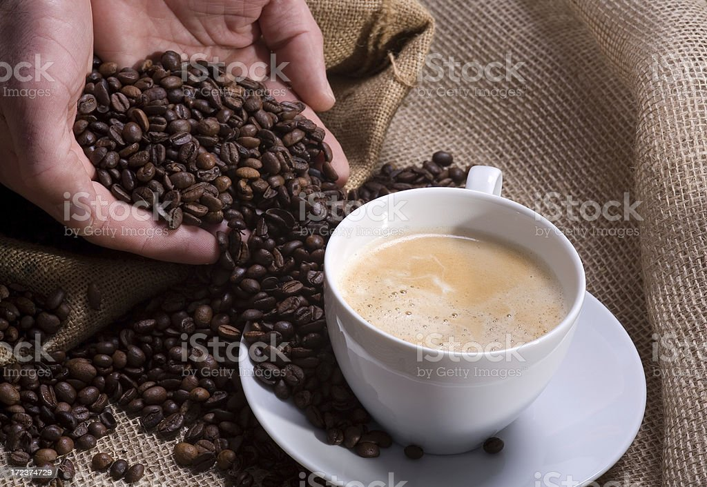 Coffee in a hand royalty-free stock photo