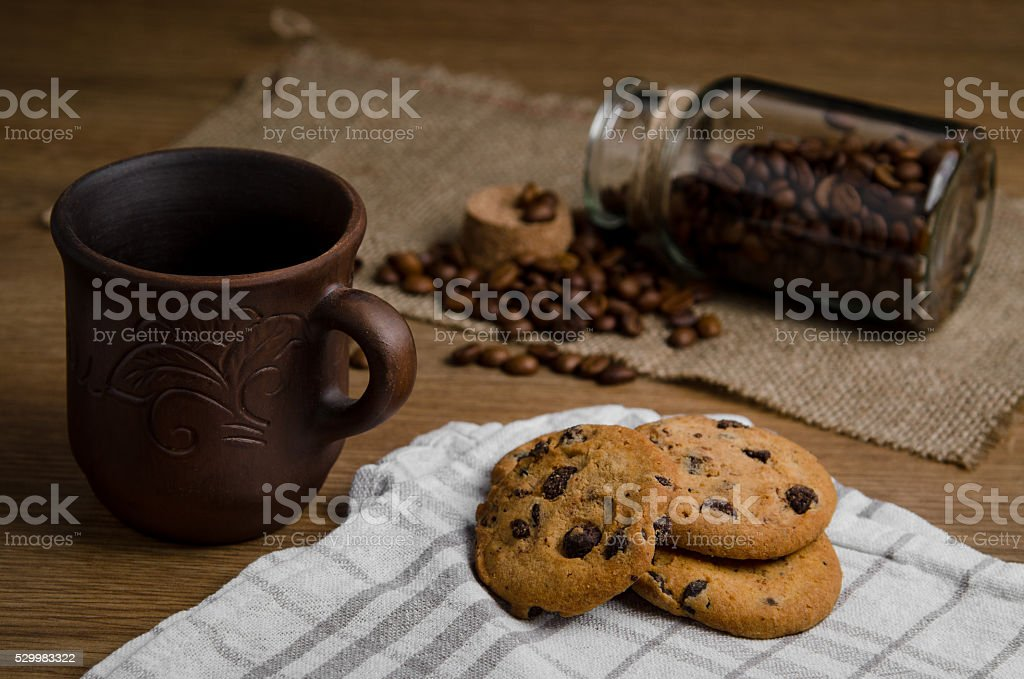 Coffee in a jar with chocolate cookies stock photo
