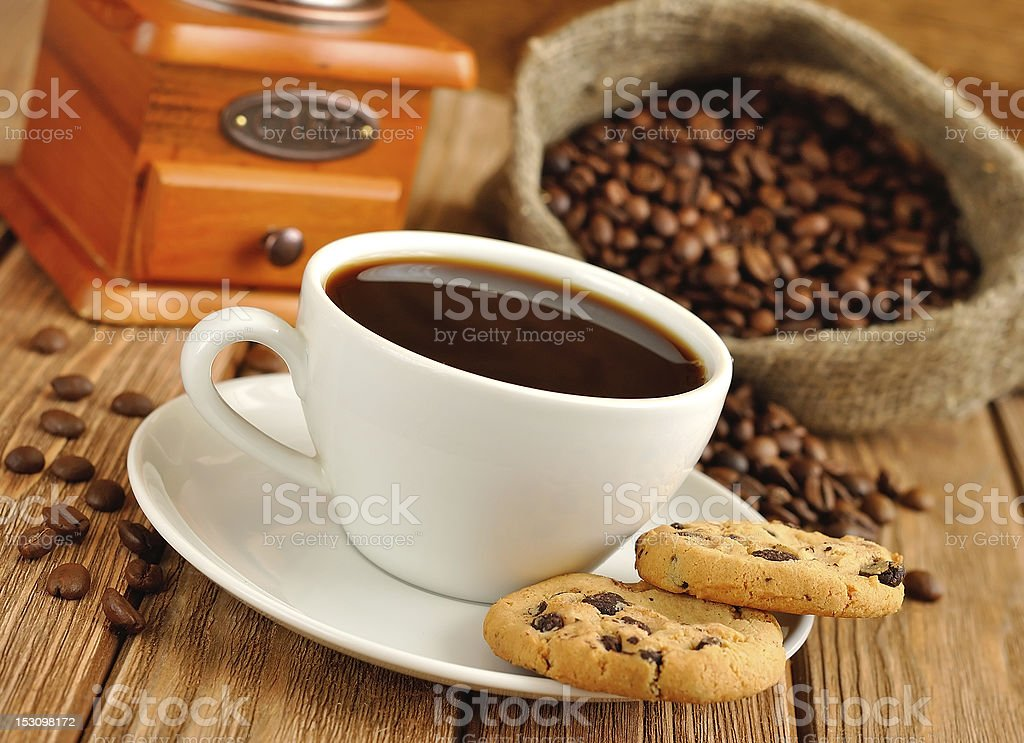 Coffee in a white cup and cookies royalty-free stock photo