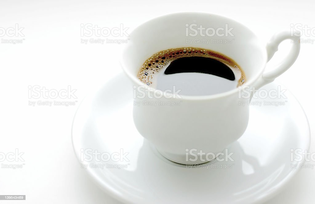 Coffee in a white cup and saucer royalty-free stock photo