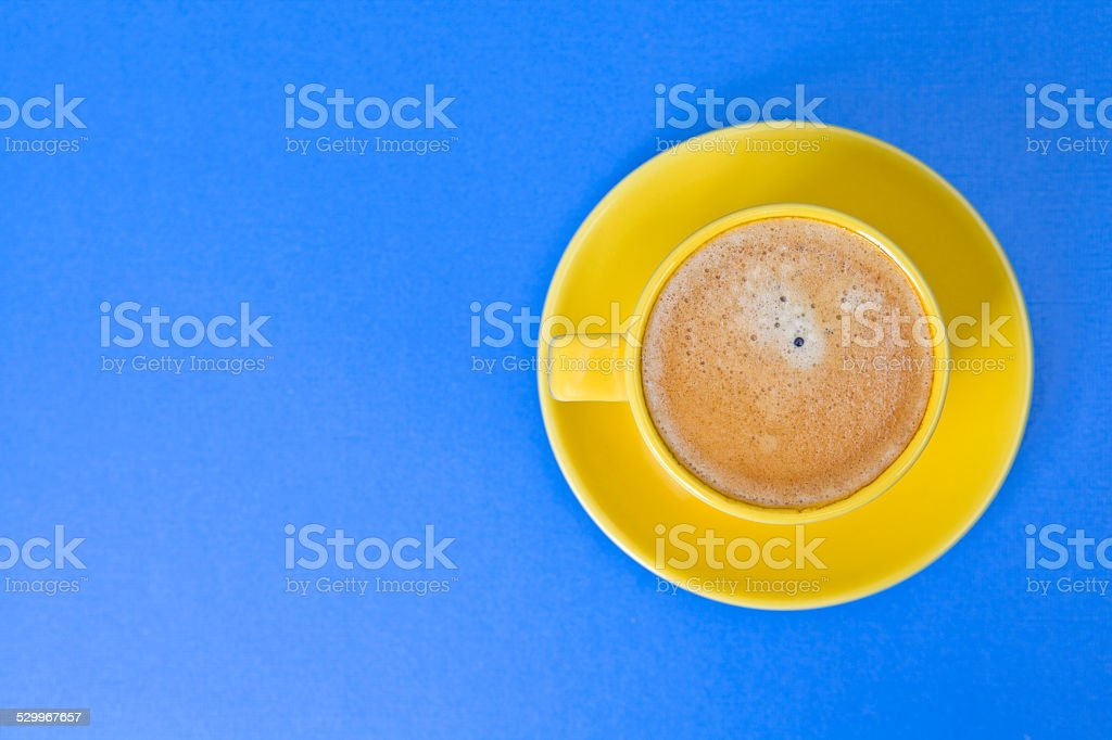 Coffee in a Yellow cup stock photo