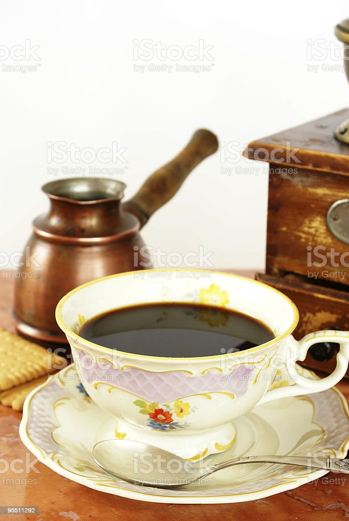 Coffee in antique china cup stock photo