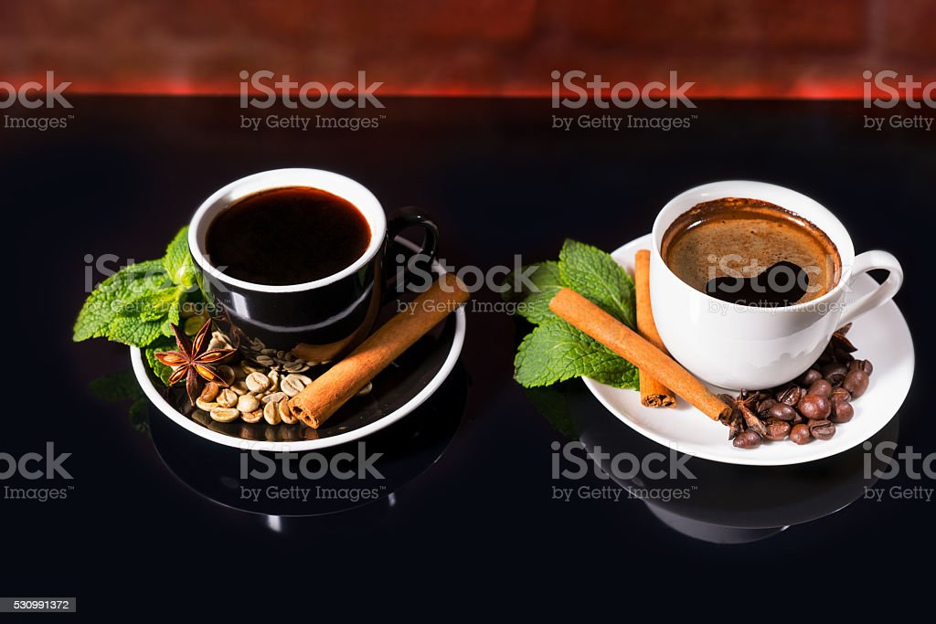 Coffee in Black and White Cups with Spices stock photo