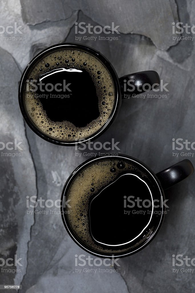 coffee in black cups on gray stone background royalty-free stock photo