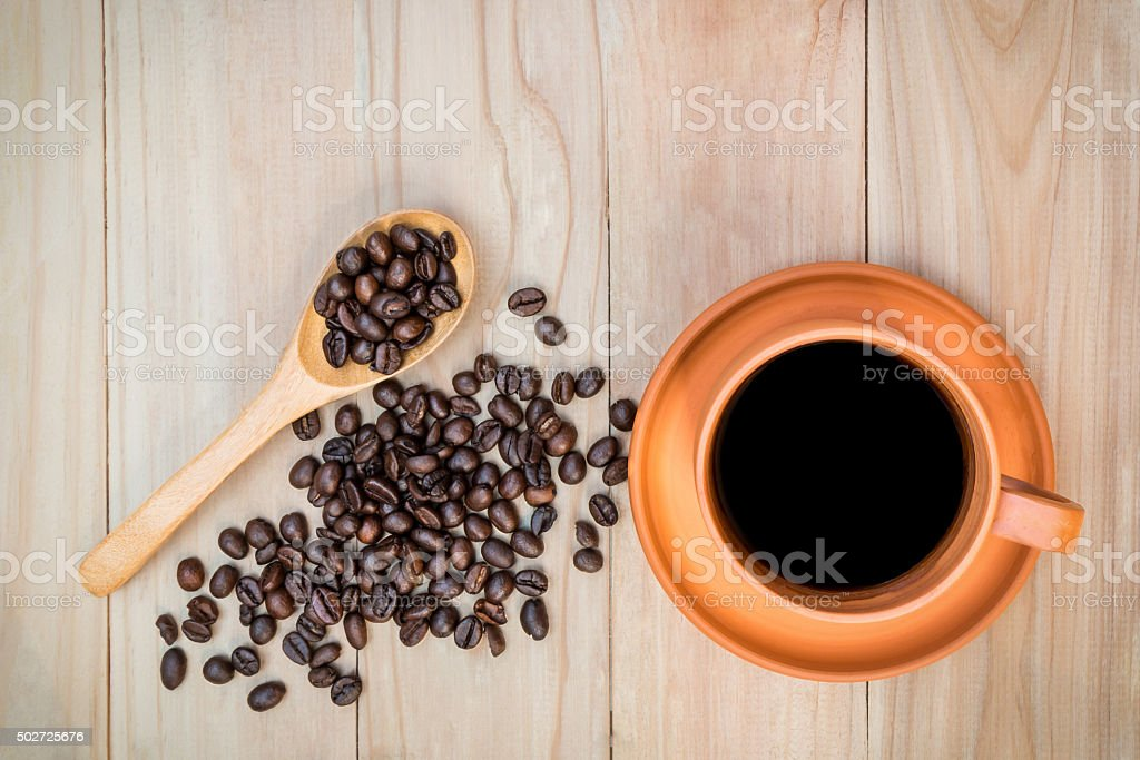 Coffee in ceramic cup and roasted coffee beans stock photo