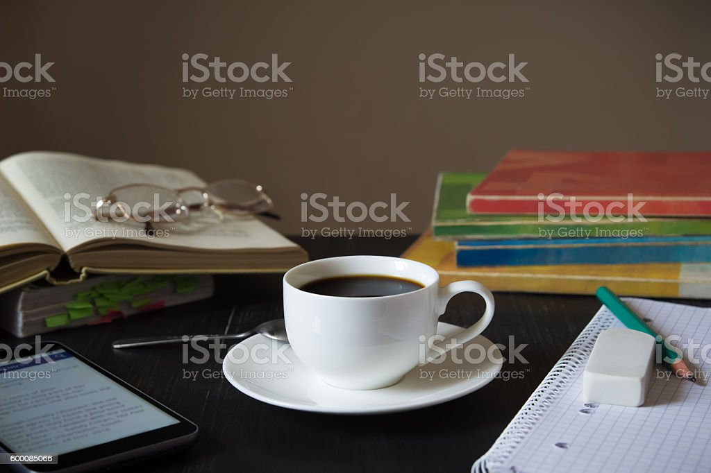Coffee in front of textbooks,smartphone and notebook stock photo
