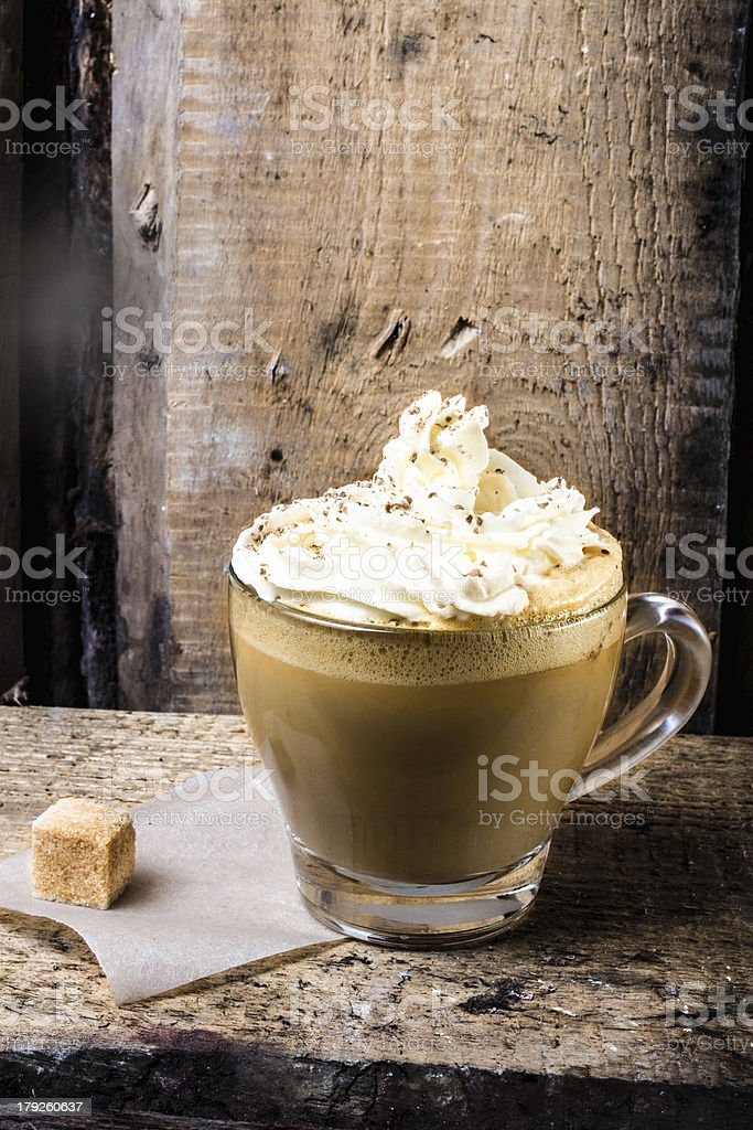coffee in glass cup with cream and  sprinkled chocolate royalty-free stock photo