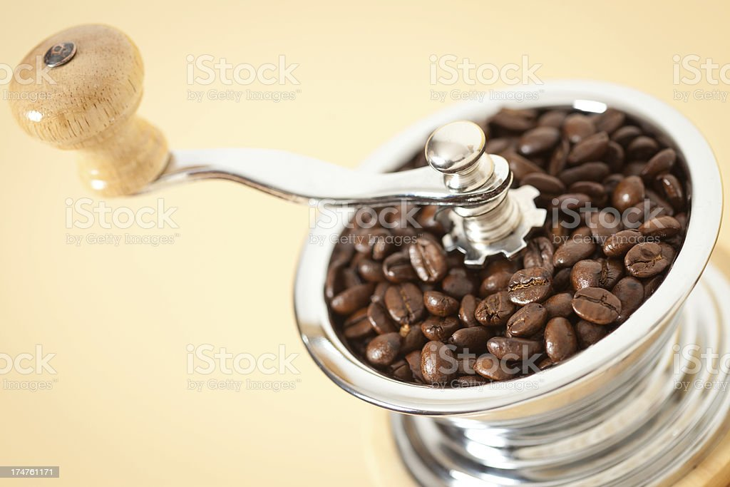 Coffee in old-fashioned grinder royalty-free stock photo