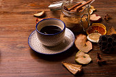 Coffee  in vintage setting with dried fruits on wooden backgroun