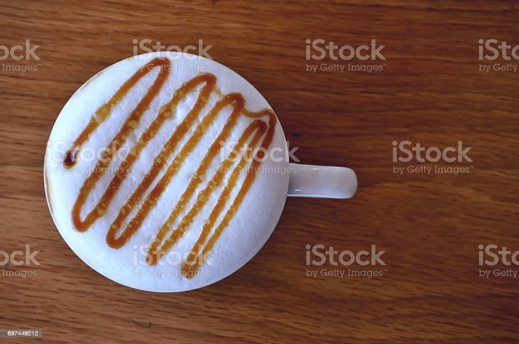 Coffee in white cup with on table wooden stock photo