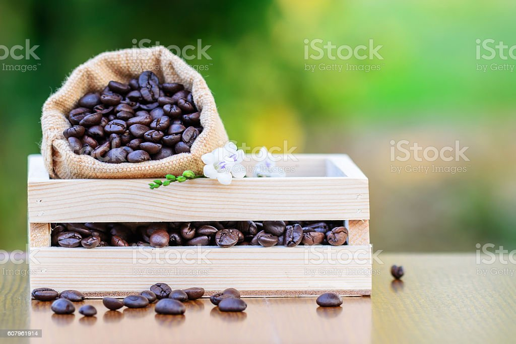 Coffee in wooden box with green blurred background stock photo