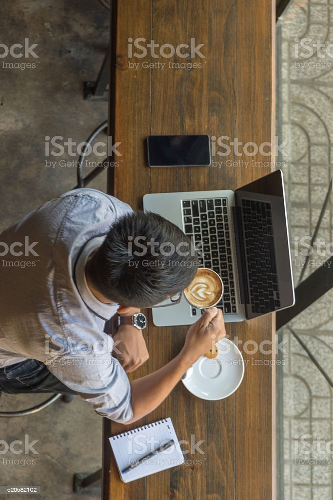Coffee is always the best friend of businessman stock photo