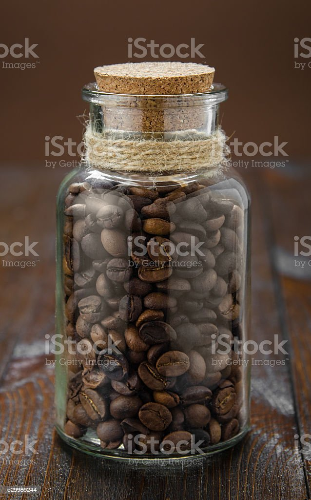 Coffee jar on wooden table stock photo