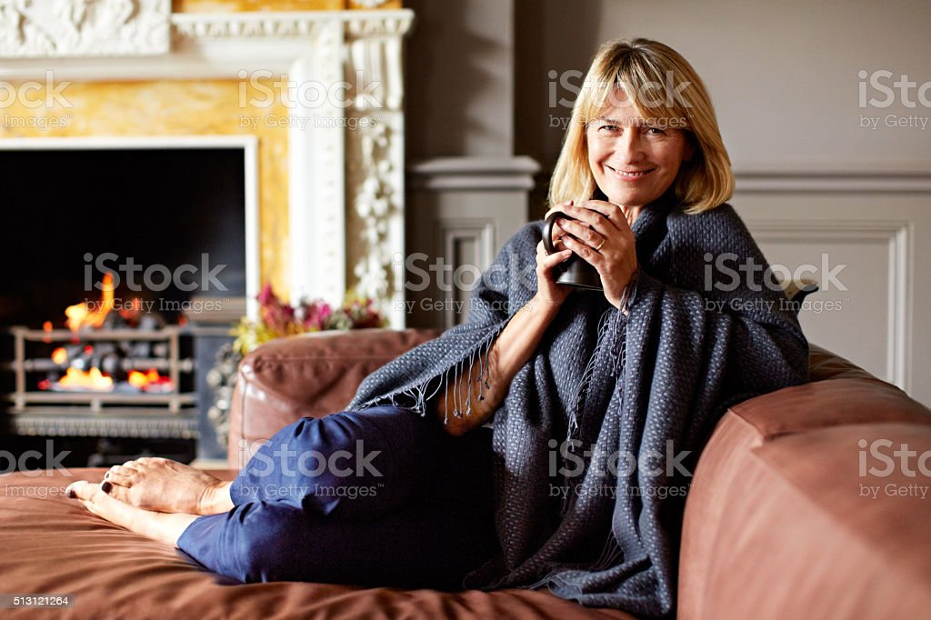 Coffee just adds to the comfort stock photo