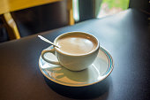 Coffee latte cup with milk on the table