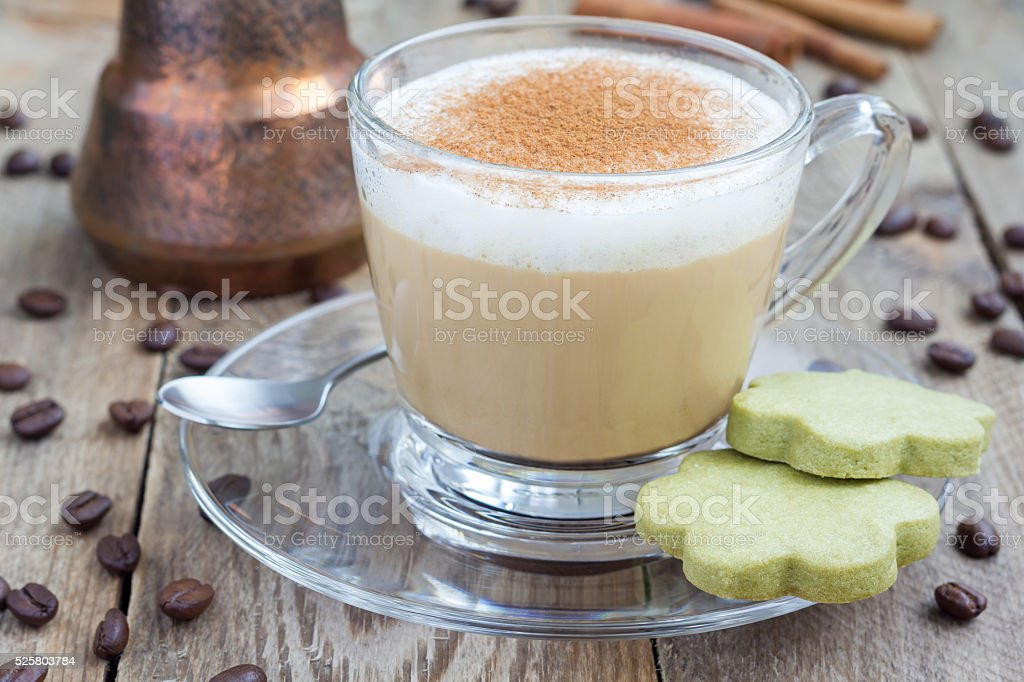 Coffee latte in glass cups with matcha cookies stock photo