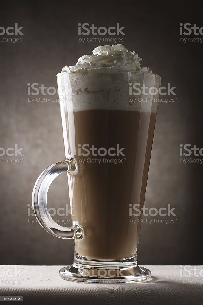 Coffee Latte in Tall Glass on brown rustic background royalty-free stock photo