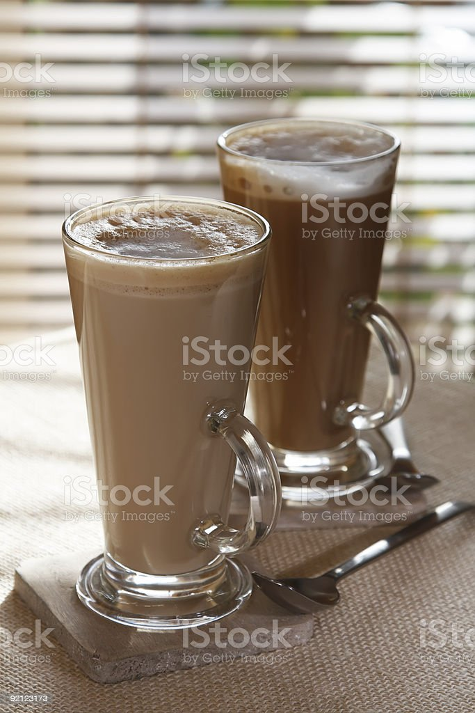 coffee latte macchiato or hot chocolate in tall glasses royalty-free stock photo