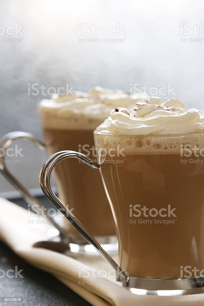 coffee latte macchiato with cream in glasses on window background royalty-free stock photo