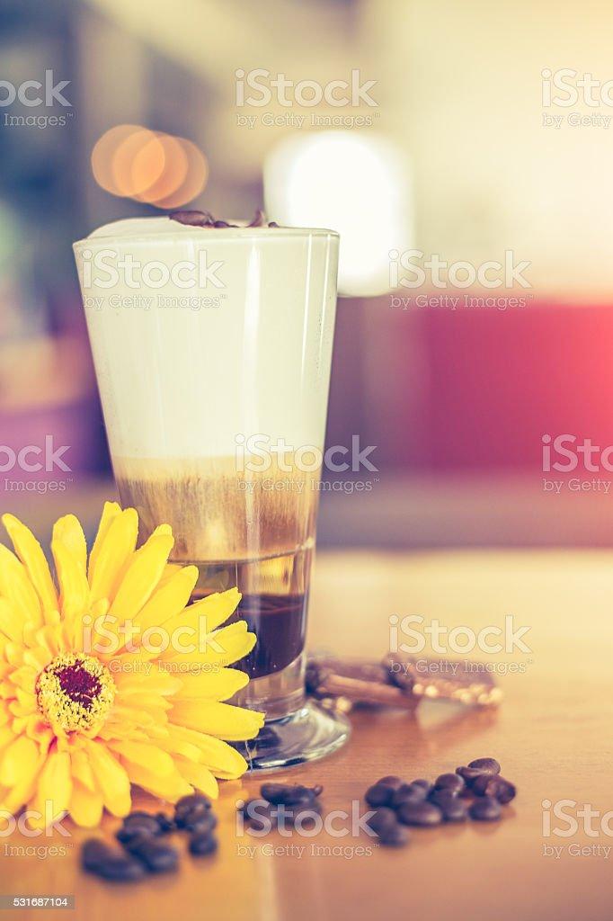 coffee latte macchiato with cream in glasses stock photo