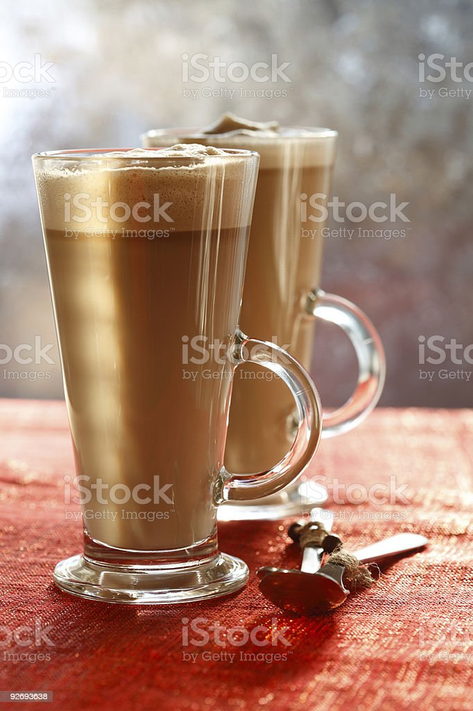Coffee Latte on glitter backdrop with sunny light royalty-free stock photo