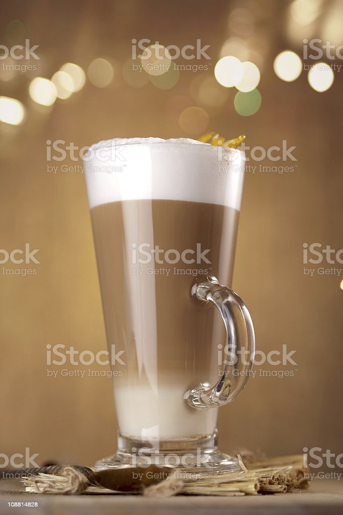 coffee latte with lights on background in a tall glass stock photo