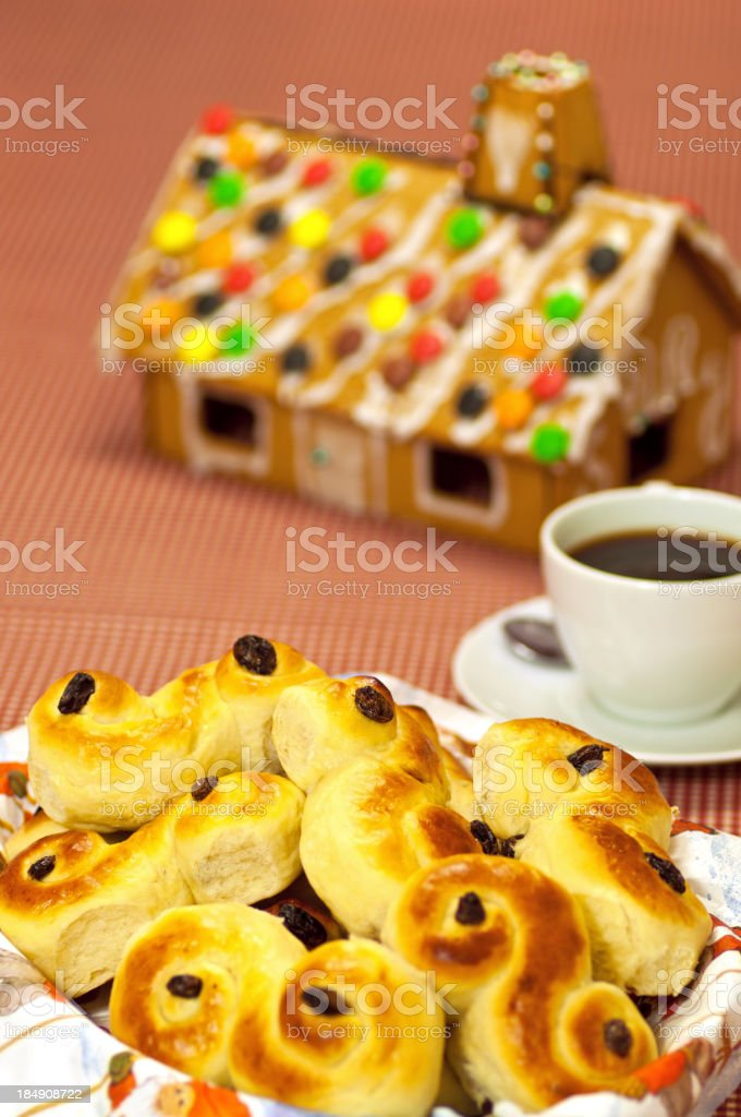 Coffee, Lucia Saffron Buns and ginger bread house stock photo