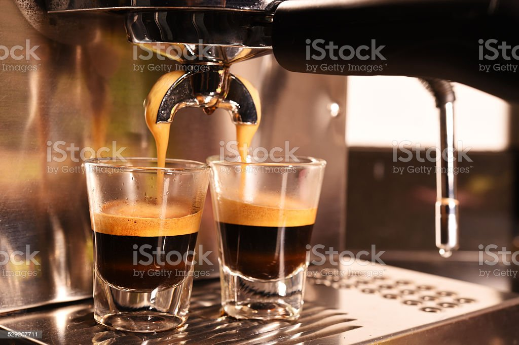 coffee machine preparing cup of coffee stock photo