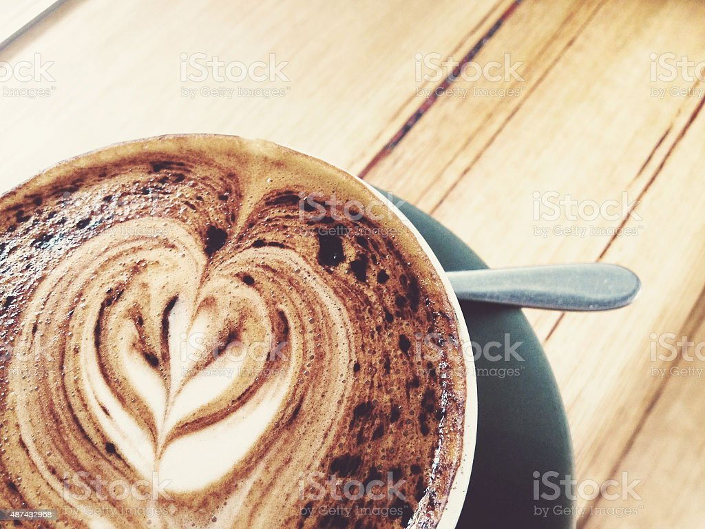 Coffee made in a cafe on a wooden bench stock photo