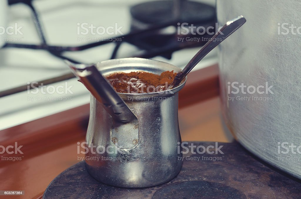 Coffee making in a traditional Albanian home. Selective focus stock photo