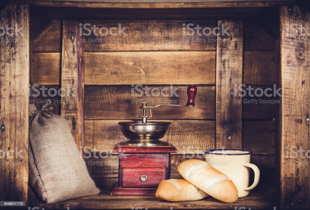 Coffee Mill Cup and burlap with coffee bean sack and bread on wooden window-shaped box stock photo