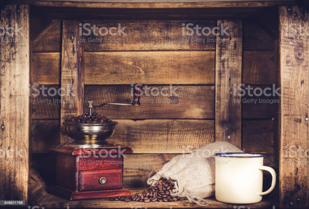 Coffee Mill Cup and burlap with coffee bean sack on wooden window-shaped box stock photo