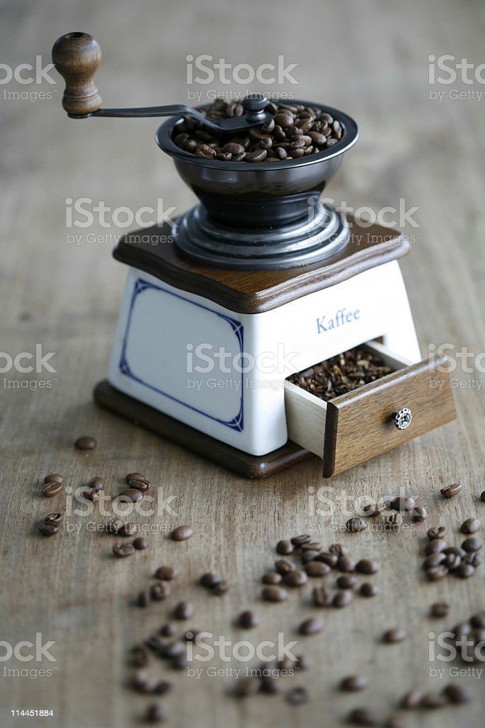 coffee mill with beans royalty-free stock photo