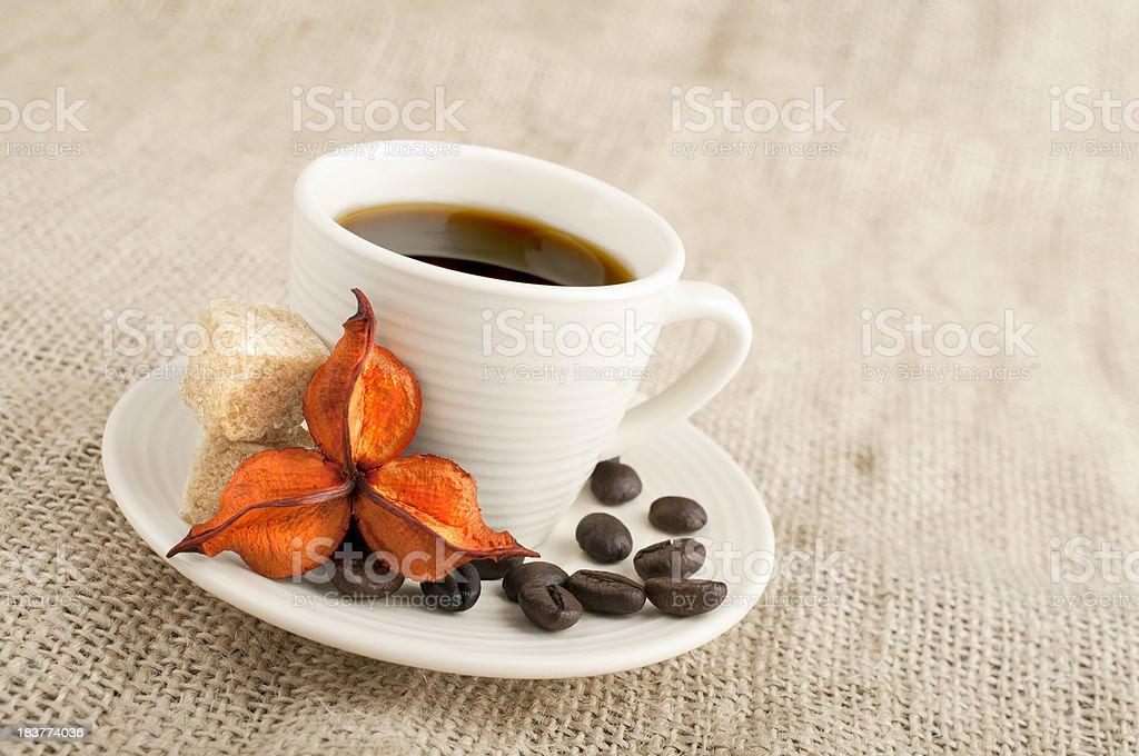 Coffee mug on burlap background royalty-free stock photo