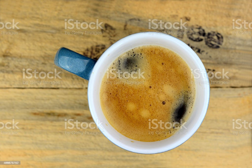 Coffee mug on old wood with text stock photo