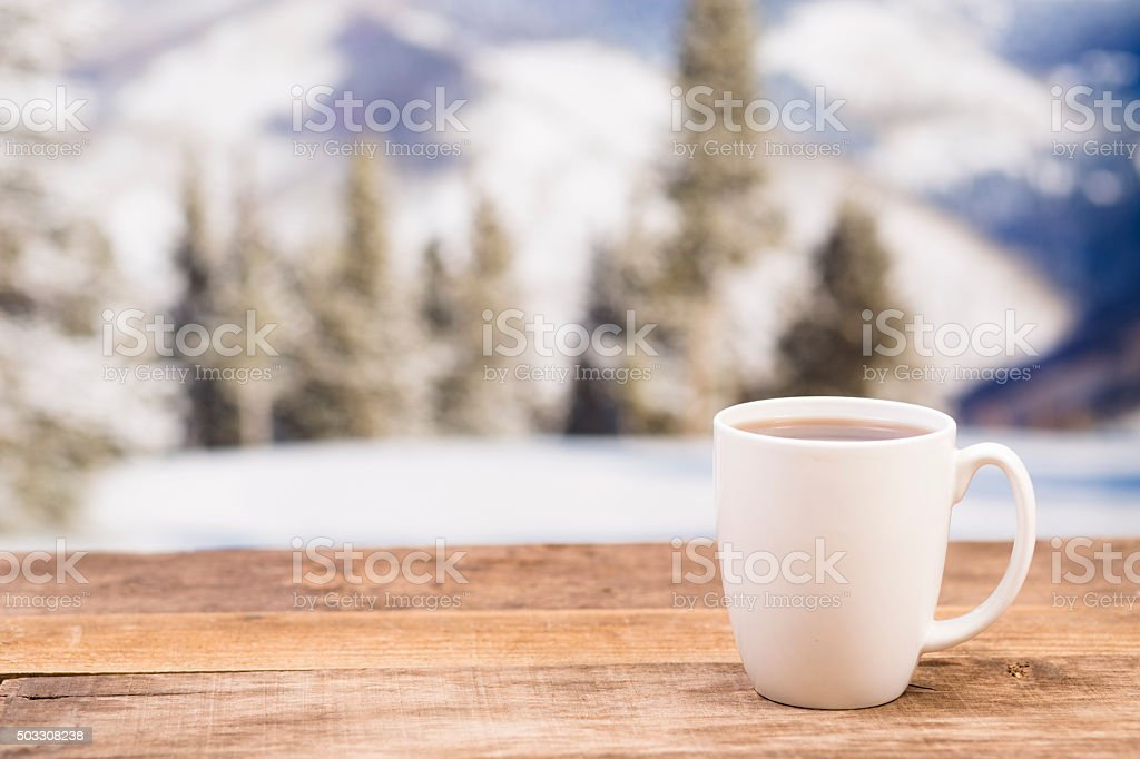 Coffee mug, table on winter background.  Relaxation. stock photo