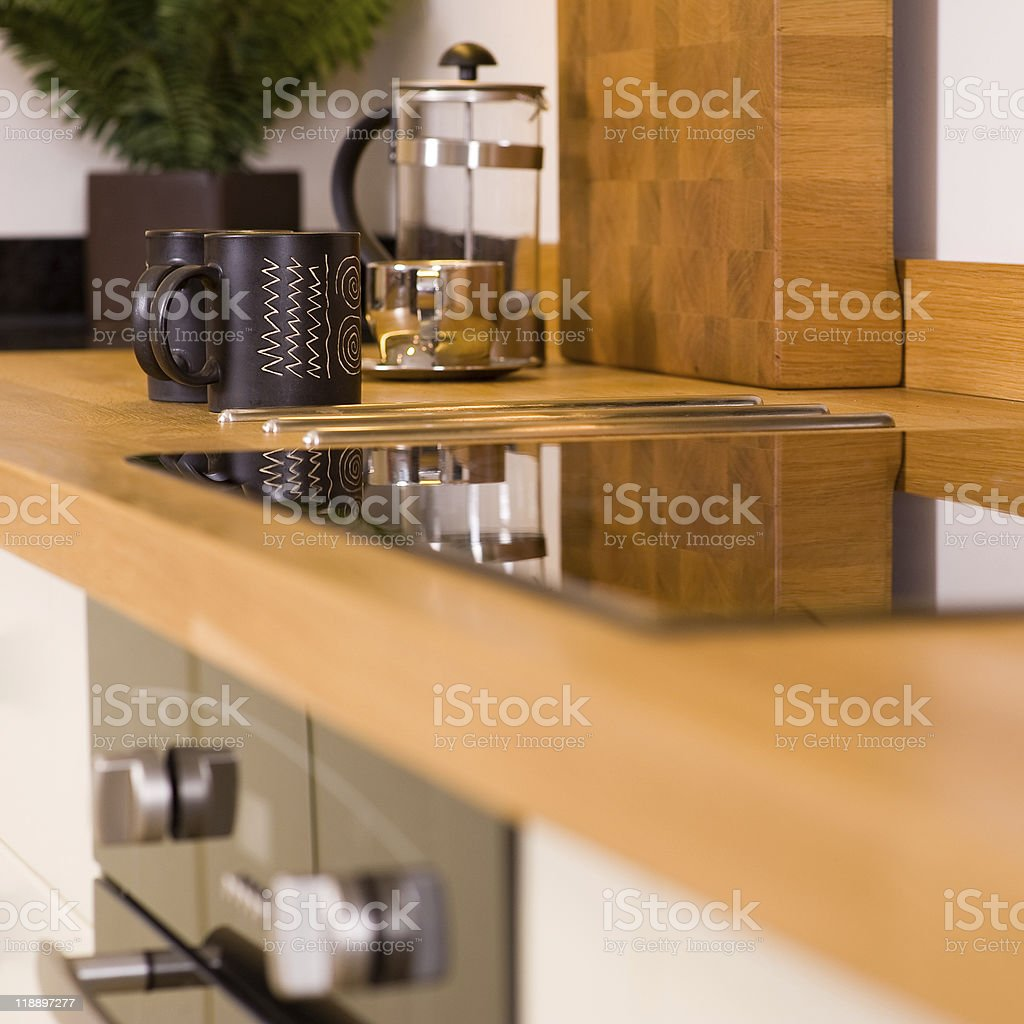 Coffee mugs in modern designer kitchen royalty-free stock photo