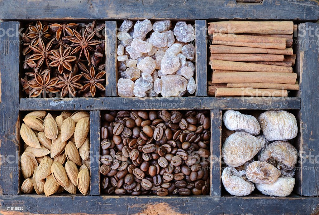 Coffee, nuts and spices in rusted wooden box royalty-free stock photo