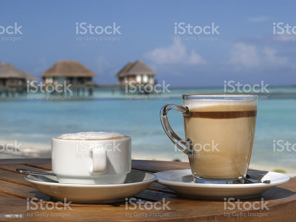 Coffee on beach in sunny day royalty-free stock photo