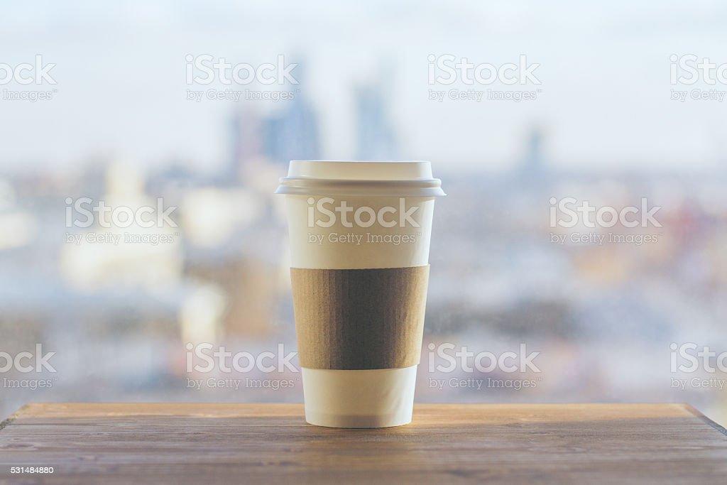 Coffee on blurry city stock photo