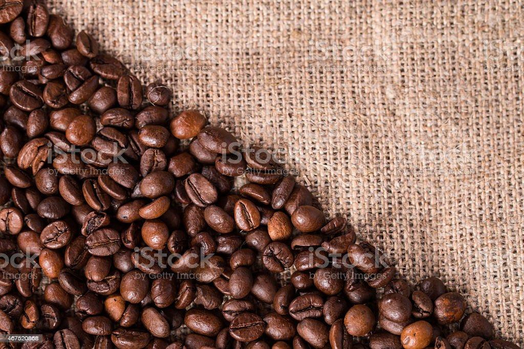 Coffee on burlap sack background stock photo