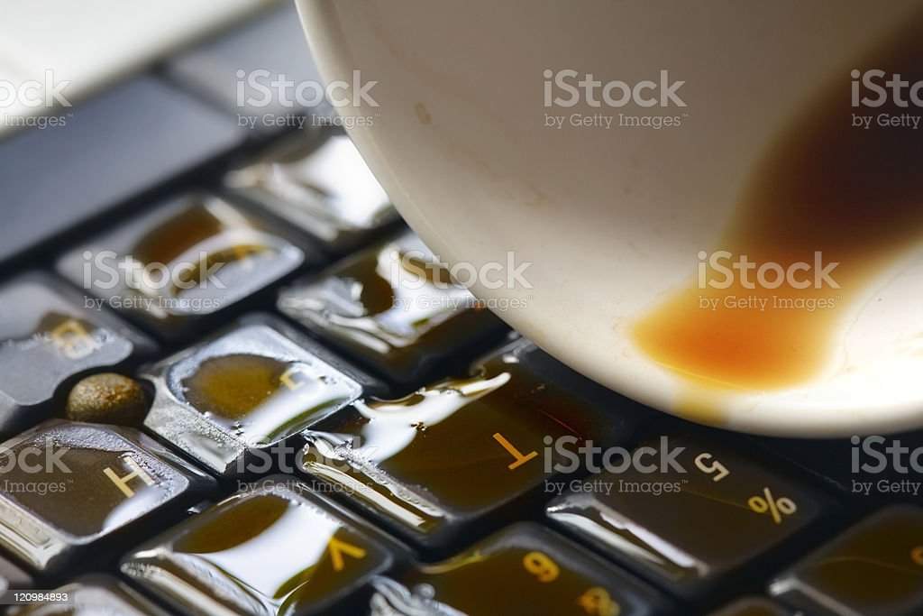 Coffee on computer keyboard stock photo