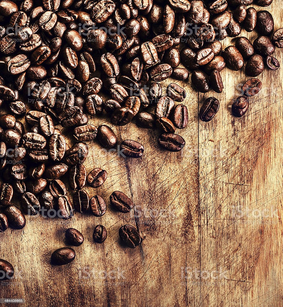 Coffee on grunge wooden background closeup. Roasted stock photo